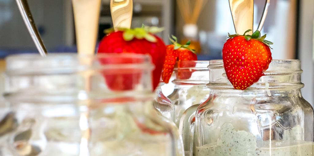 Dairy free breakfast smoothie of avocado, berries and kale