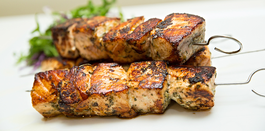 Grilled salmon skewers are great for the bbq and delicious served with guacamole and salad.