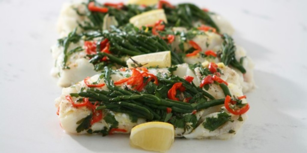 Foil-wrapped light fish dish with samphire and lemon